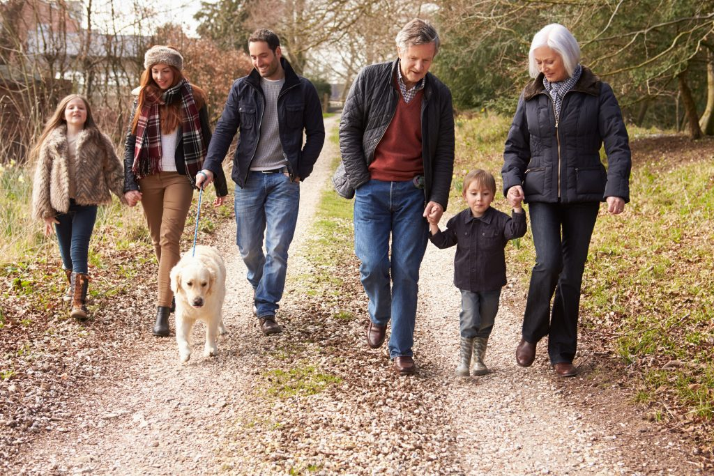 multi generational family walking